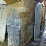 Cleaned Limestone wall revealing calcification on walls