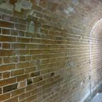 cleaned brick walls - note damage to bricks
